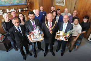24/06/15 Mill Road traders welcoming new mayor 24/06/15 The Mill Road Traders Association welcoming the new Cambridge mayor with a basket of gifts. Robert Dryden. Picture: David Johnson